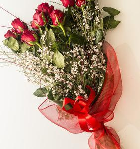 11 red roses with greens